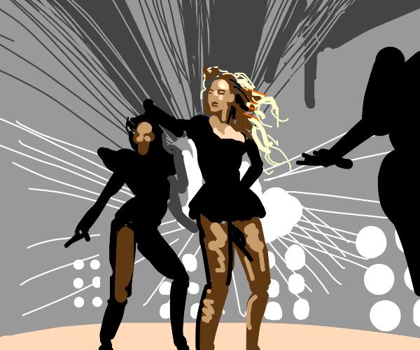 3 ladies dancing on stage