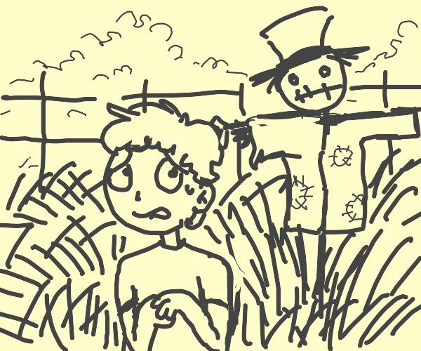 guy afraid of scarecrow