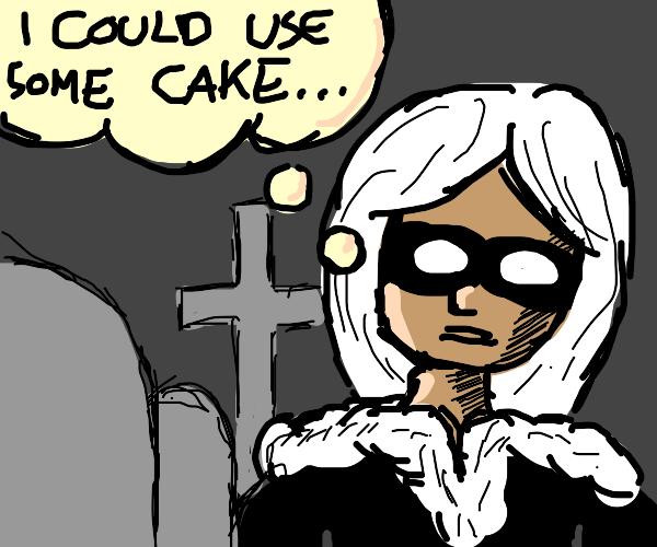 black cat in graveyard, craving some cake