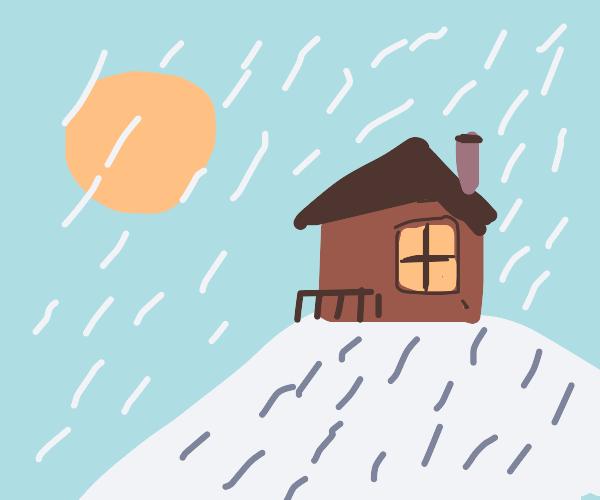 cabin in a snowy hill