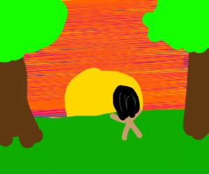 Naked man in front of sunset