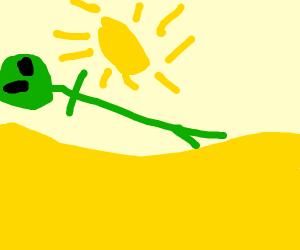 Green alien long in desert while its morning