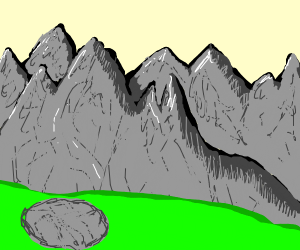 Rock in front of mountains