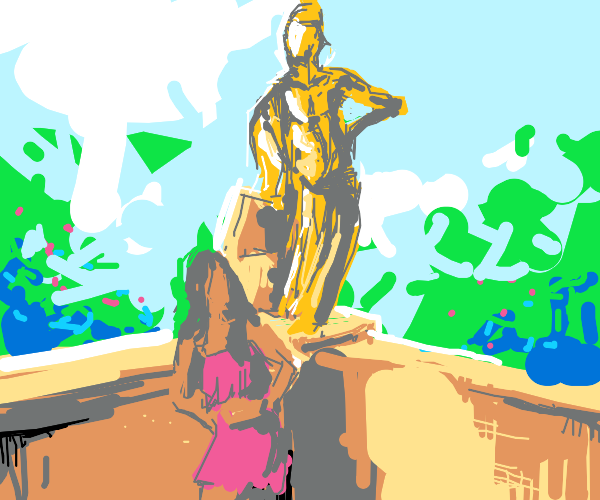 Girl in red is amazed at gold statue