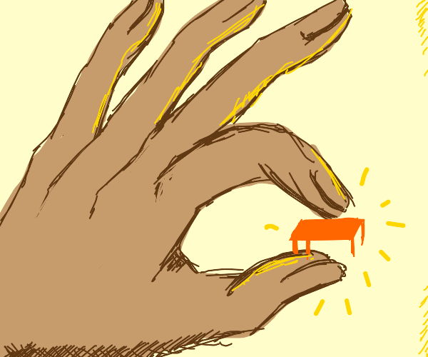 a giant hand picking up a teeny desk