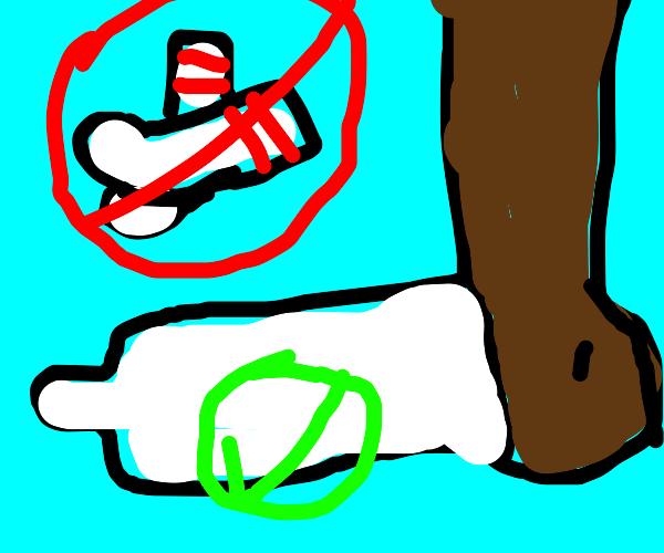 Man puts foot into a condom instead of a sock