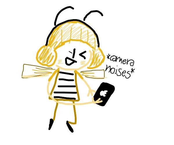 Cute bee girl takes a selfie.