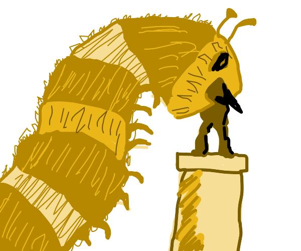 Giant caterpillar eats sculpture