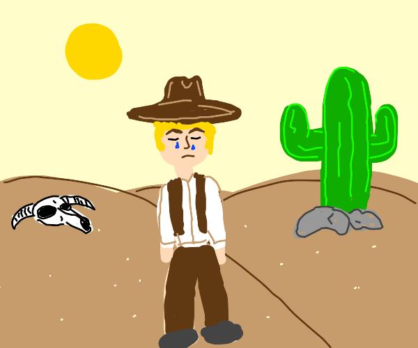 sad cowboy in desert