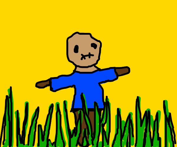 sad scarecrow in overgrown grass