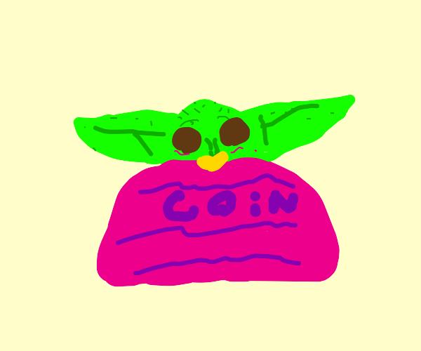 baby yoda in a pink coin purse