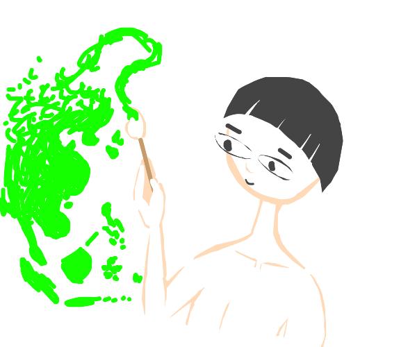 Asian boy painting green