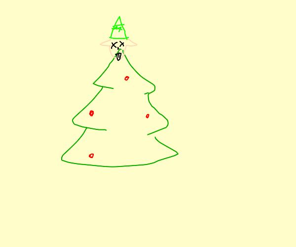 Elf head above christmas tree