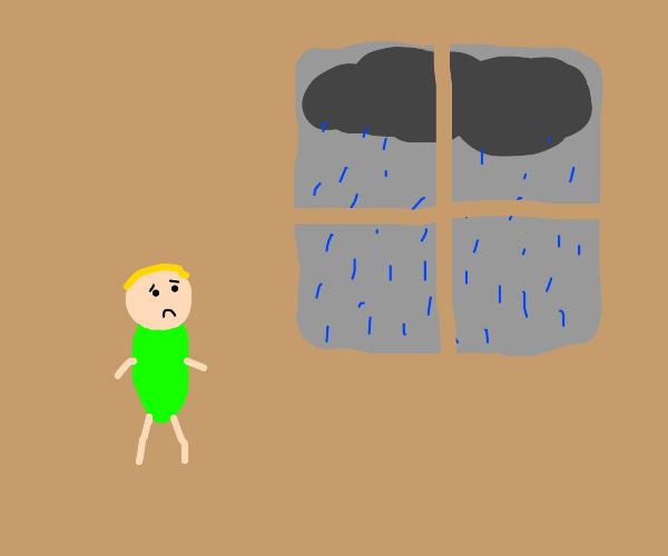 Sad Boy looks out window at rain