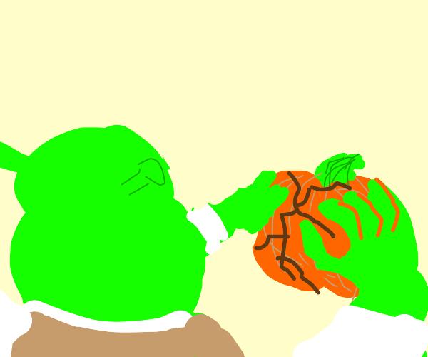 Shrek crushes a pumpkin