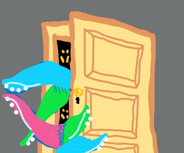 Tentacle alien opening a door
