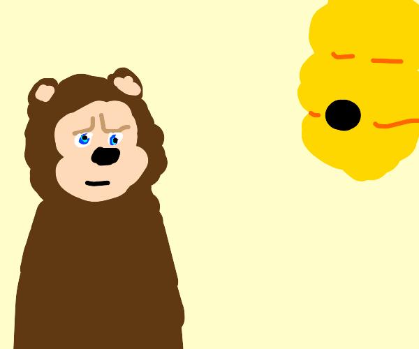 angery bear look at beehive