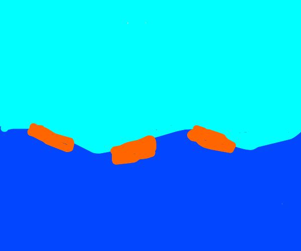 3 sponges floating in the ocean