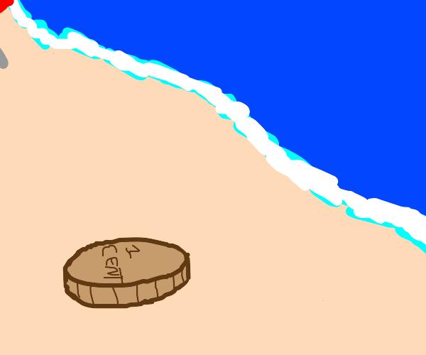 1 cent coin on beach