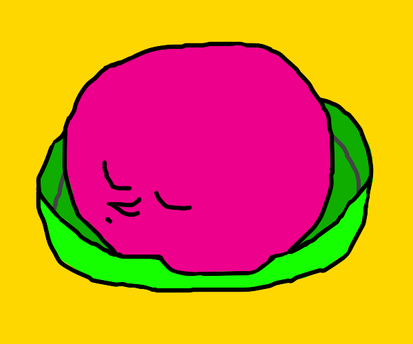 A round, pink creature in bed.