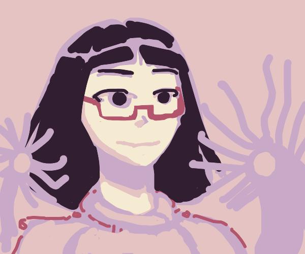Girl w/ glasses next to a couple sea anemone