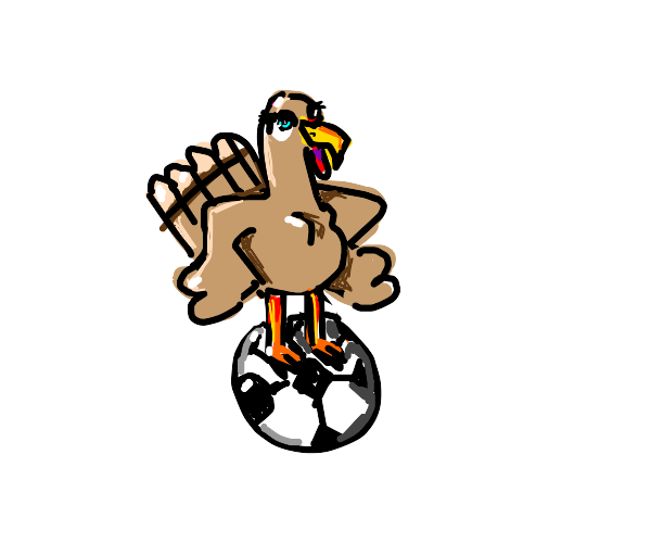 Turkey standing above a football.