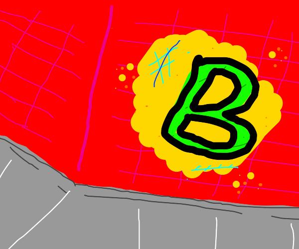 "street art on brick buildingof the letter ""B"""