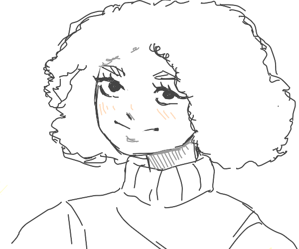Person with fluffy hair and baggy sweater