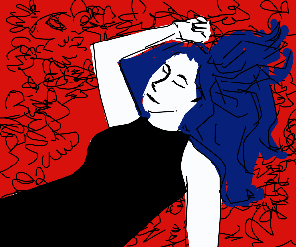 Girl laying in a bed of roses