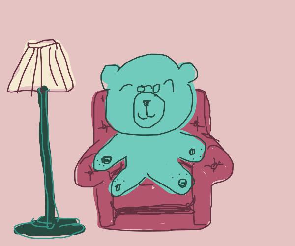 blue teddy bear on a red chair