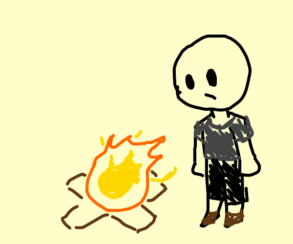 man looking at a fire