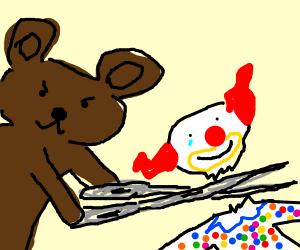 Teddy bear cuts off clown's head.