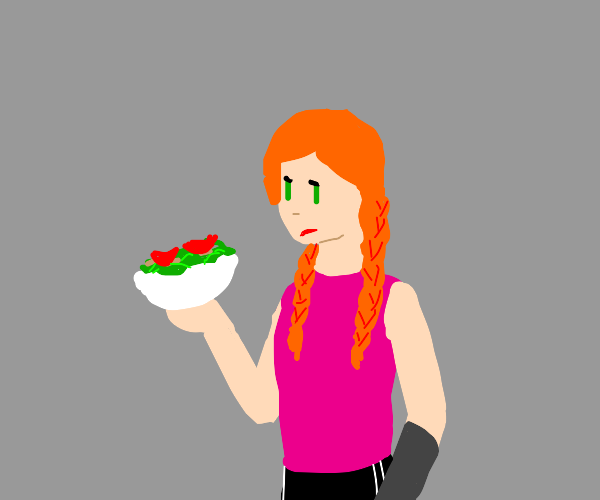 Red haired girl eating salad