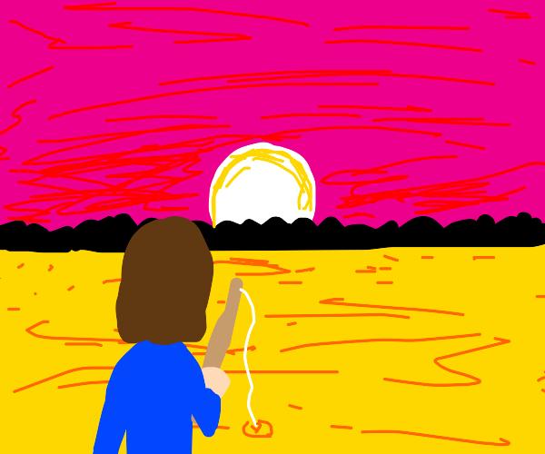 Fishing in yellow lake at sunset