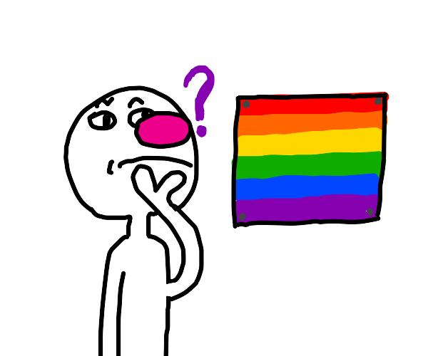 Guy confused at pride flag