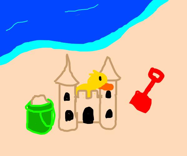 duck builds sandcastle
