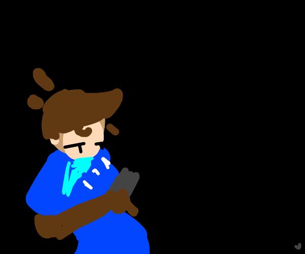blue t-shirt boy using his phone in the dark