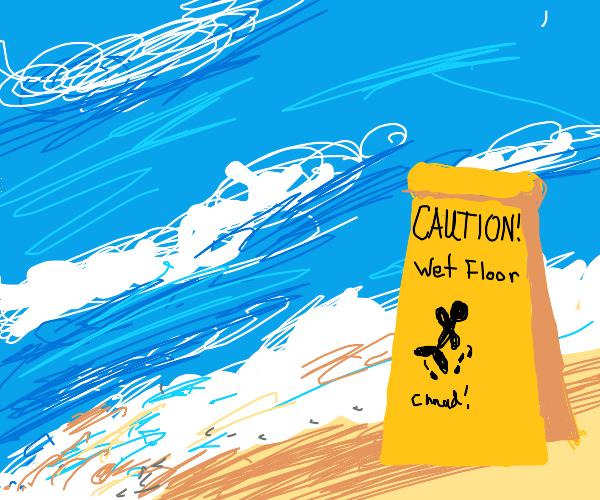 A wet floor sign at the beach