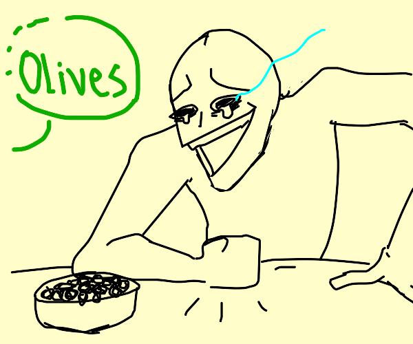 Man laughs at olives