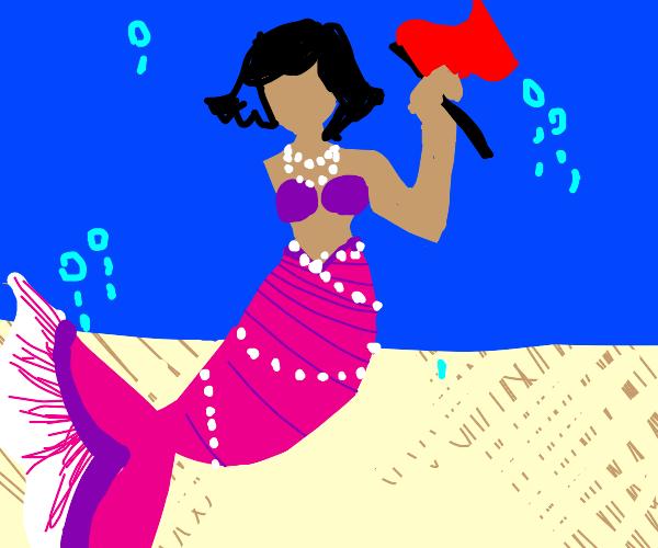 a mermaid holding a flag