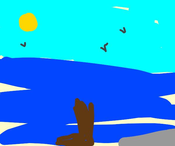 Cowboy boot in ocean