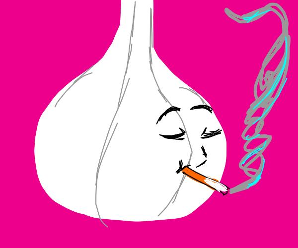 Head of garlic smokes