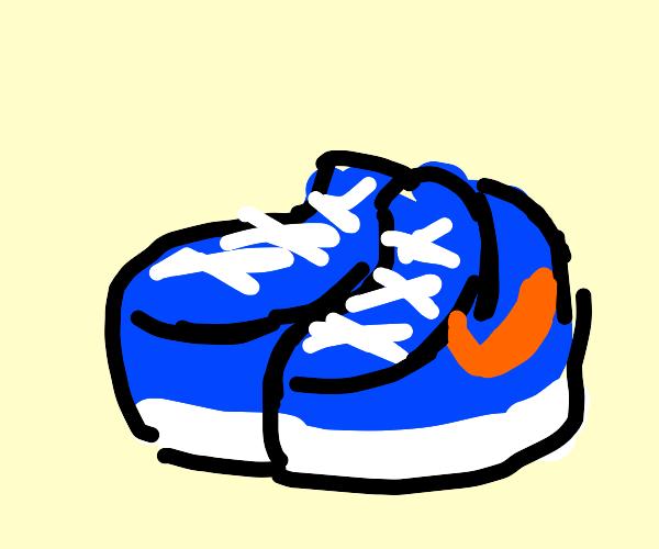 Blue and white shoes with orange Nike logo