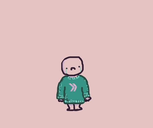 sad kid in a sweatshirt