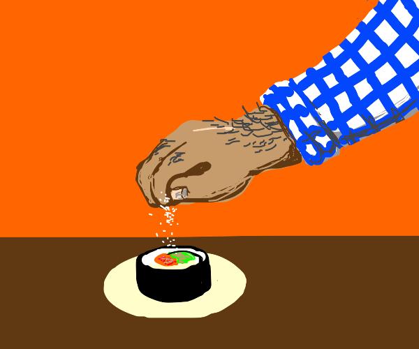 Man pouring salt on sushi