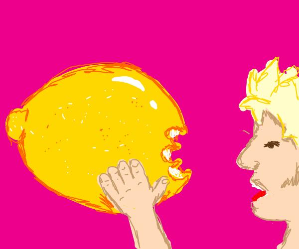 Blonde guy eats a massive lemon