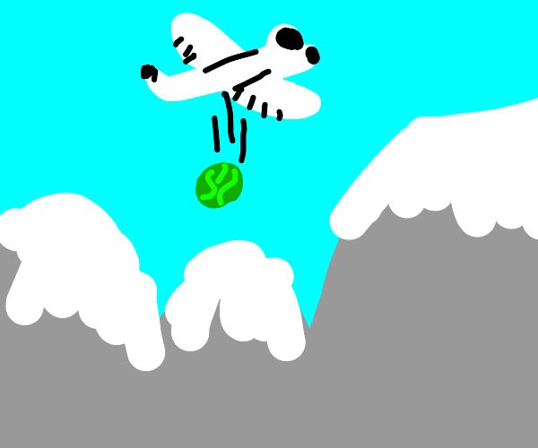airplane deploys watermelon on mountains