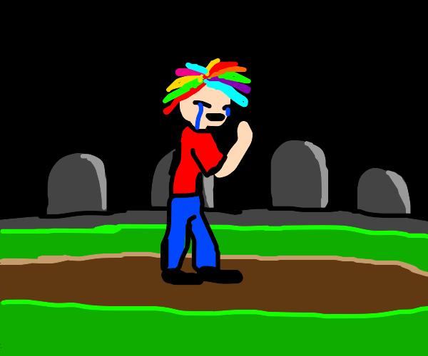 Rainbow hair boy cries at a cemetary