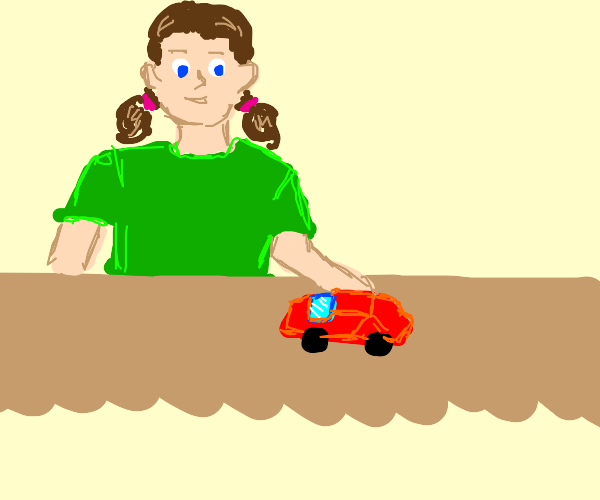 Girl in green has fun with red toy car