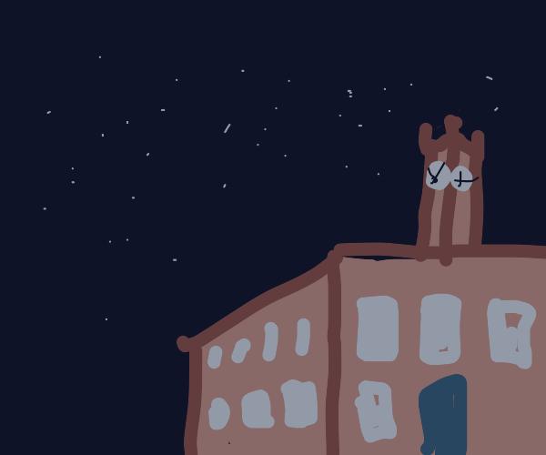 cliffside clock tower at night